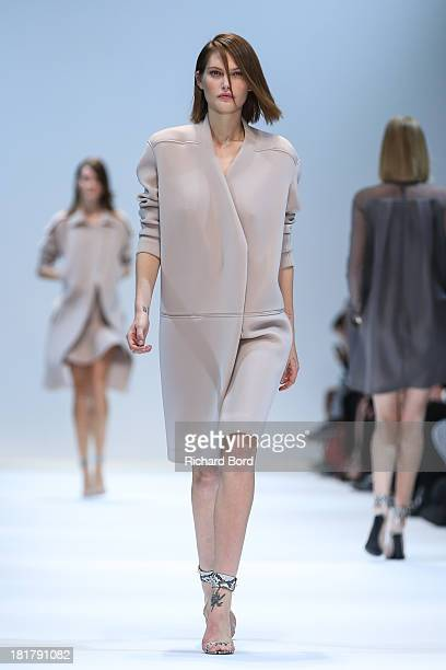 A model walks the runway during the Guy Laroche show at Grand Palais as part of the Paris Fashion Week Womenswear Spring/Summer 2014 on September 25...