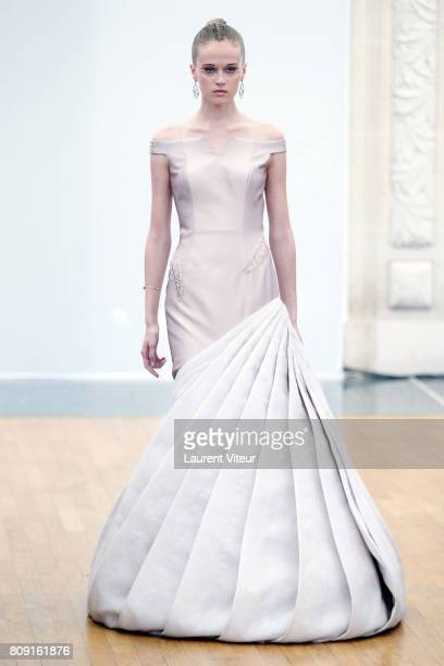 A model walks the runway during the Gyunel Haute Couture Fall/Winter 20172018 show as part of Haute Couture Paris Fashion Week on July 5 2017 in...