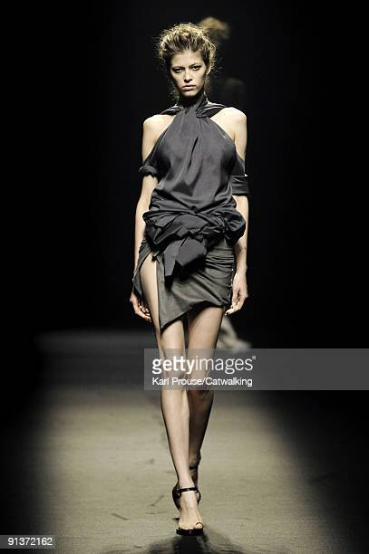 Model walks the runway during the Haider Ackermann Pret a Porter show during Paris Womenswear Fashion Week Spring/Summer 2010 at Les Beaux-Arts de...