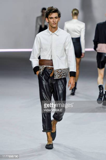 Model walks the runway during the Haider Ackermann Ready to Wear Spring/Summer 2020 fashion show as part of Paris Fashion Week on September 28, 2019...
