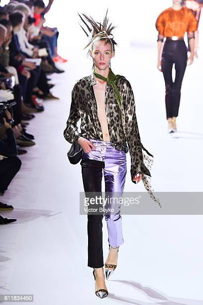A model walks the runway during the Haider Ackermann show as part of the Paris Fashion Week Womenswear Spring/Summer 2017 on October 1 2016 in Paris...