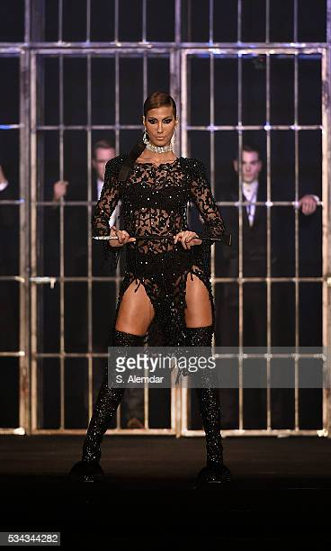 A model walks the runway during the Hakan Akkaya Fall/Winter 16/17 fashion show at Maslak Arena on May 25 2016 in Istanbul Turkey