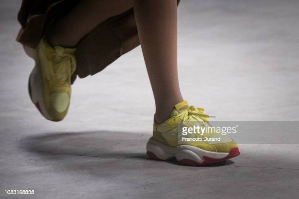 A model walks the runway during the Han Kjobenhavn X Puma Menswear Fall/Winter 20192020 show as part of Paris Fashion Week on January 15 2019 in...