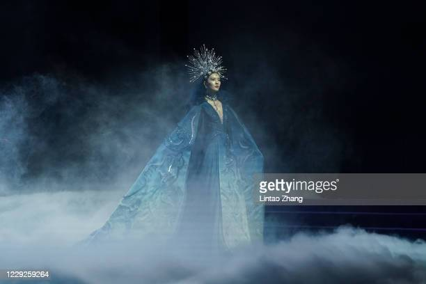 Model walks the runway during the Heaven Gaia collection show by Chinese designer Xiong Ying on day one of China Fashion Week at 751D.PARK on October...