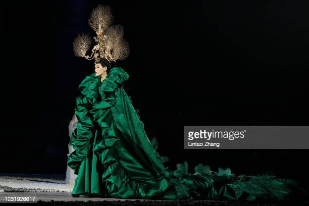 Model walks the runway during the Heaven Gaia collection show by Chinese designer Xiong Ying on day two of China Fashion Week A/W 2021/2022 at...