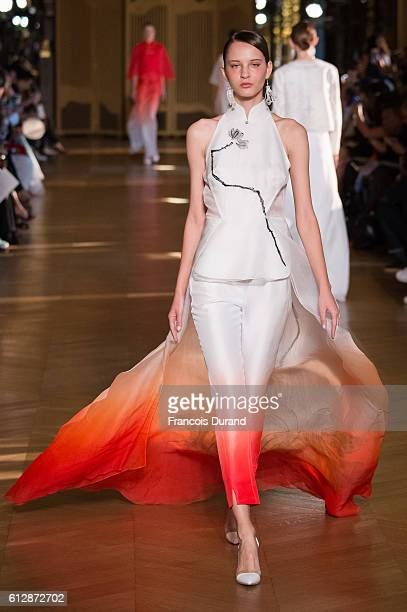 A model walks the runway during the Heaven Gaia show as part of the Paris Fashion Week Womenswear Spring/Summer 2017 on October 5 2016 in Paris France