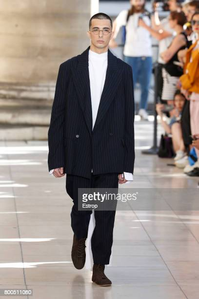 A model walks the runway during the Hed Mayner Menswear Spring/Summer 2018 show as part of Paris Fashion Week on June 23 2017 in Paris France