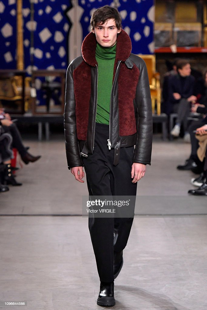 c717a959 A model walks the runway during the Hermes Menswear Fall/Winter ...