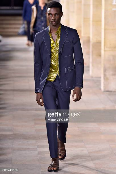 A model walks the runway during the Hermes Menswear Spring/Summer 2018 show as part of Paris Fashion Week on June 24 2017 in Paris France