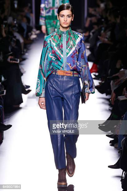 A model walks the runway during the Hermes Ready to Wear fashion show as part of the Paris Fashion Week Womenswear Fall/Winter 2017/2018 on March 6...