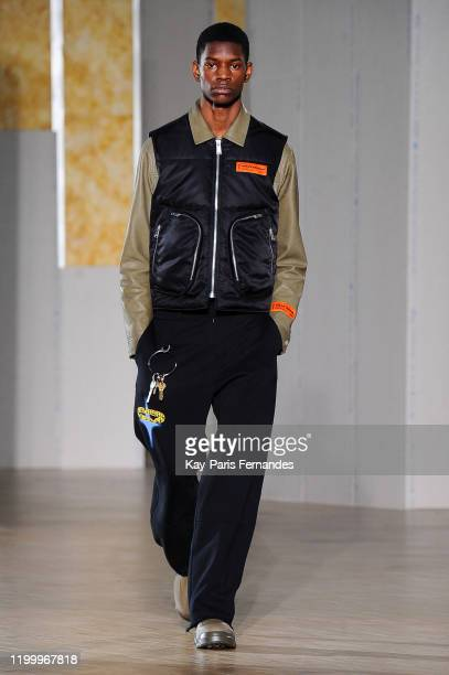 Model walks the runway during the Heron Preston Menswear Fall/Winter 2020-2021 show as part of Paris Fashion Week At le Carreau Du Temple on January...