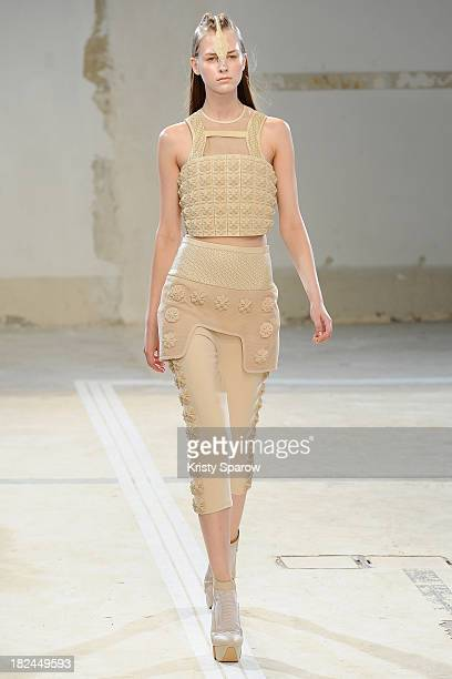 A model walks the runway during the Hexa By Kuho show as part of Paris Fashion Week Womenswear Spring/Summer 2014 on September 29 2013 in Paris France