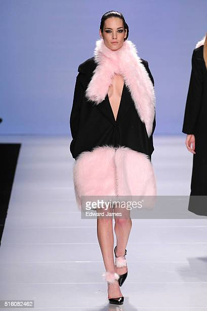 A model walks the runway during the Hillary Macmillan fashion show at David Pecaut Square on March 16 2016 in Toronto Canada