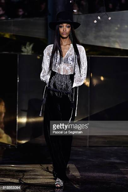 A model walks the runway during the HM show as part of the Paris Fashion Week Womenswear Fall/Winter 2016/2017 on March 2 2016 in Paris France
