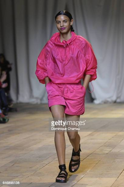 A model walks the runway during the HM Studio SS17 show as part of the Paris Fashion Week on March 1 2017 in Paris France