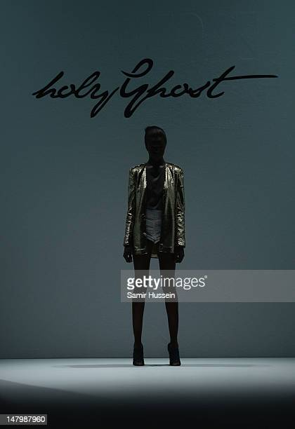 A model walks the runway during the Holy Ghost Show at MercedesBenz Fashion Week Spring/Summer 2013 on July 7 2012 in Berlin Germany