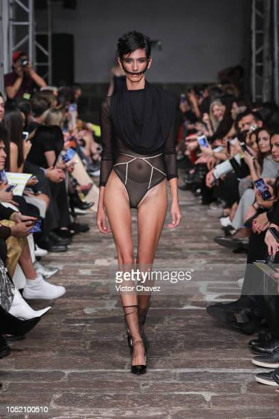 A model walks the runway during the Hua Lingerie fashion show at Mercedes Benz Fashion Week Mexico 2018 at Ex Convento de San Hipolito on October 13...