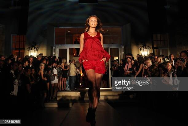 Model walks the runway during the Hugo Boss fashion show in Nettleton Road on the Atlantic seaboard on December 04, 2010 in Cape Town, South Africa....