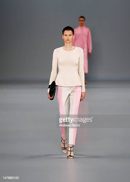 A model walks the runway during the Hugo By Hugo Boss Show at the MercedesBenz Fashion Week Spring/Summer 2013 on July 5 2012 in Berlin Germany