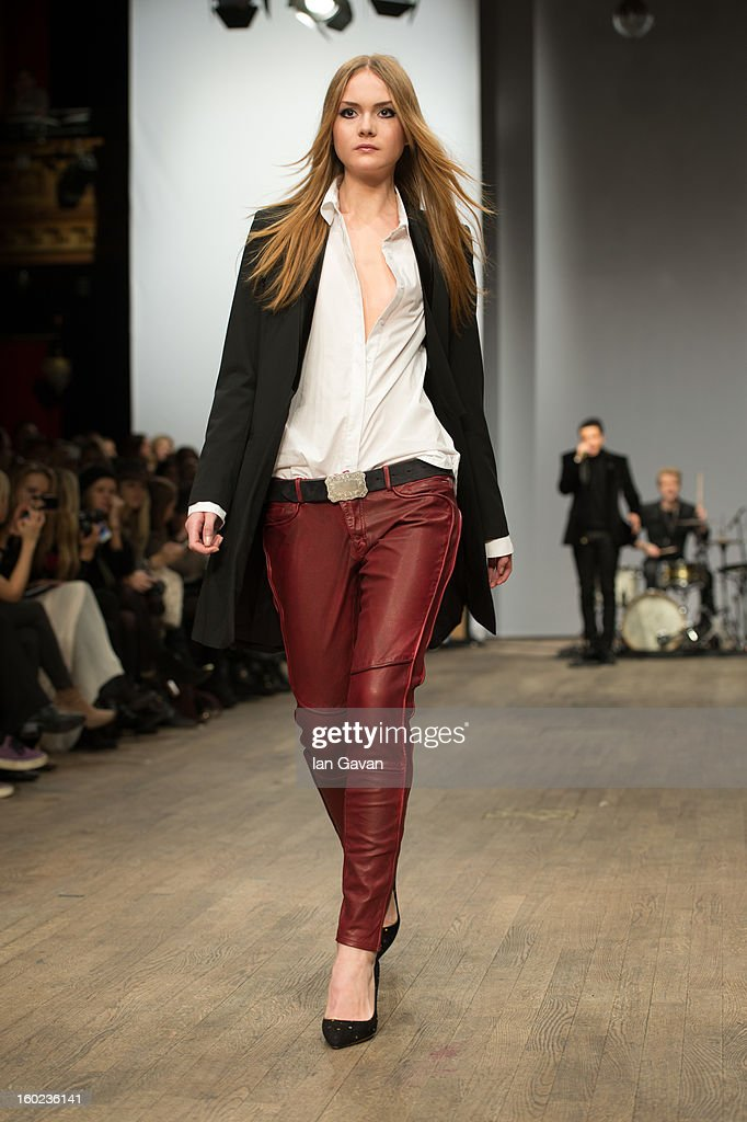 A model walks the runway during the Hunkydory show at Mercedes-Benz Stockholm Fashion Week A/W 13 at Berns on January 28, 2013 in Stockholm, Sweden.