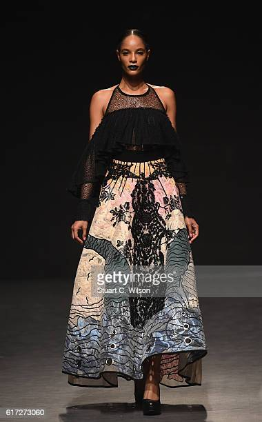 A model walks the runway during the Hussein Bazaza show at Fashion Forward Spring/Summer 2017 held at the Dubai Design District on October 22 2016 in...