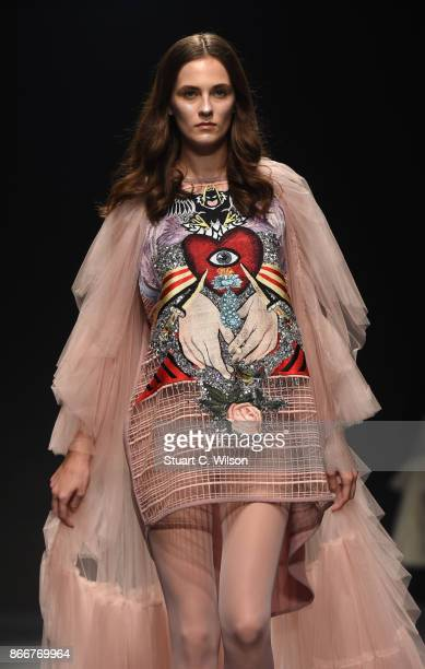 A model walks the runway during the Hussein Bazaza show at Fashion Forward October 2017 held at the Dubai Design District on October 26 2017 in Dubai...