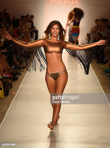 A model walks the runway during the Indah fashion show at MercedesBenz Fashion Week Swim 2015 at Cabana Grande at the Raleigh on July 21 2014 in...
