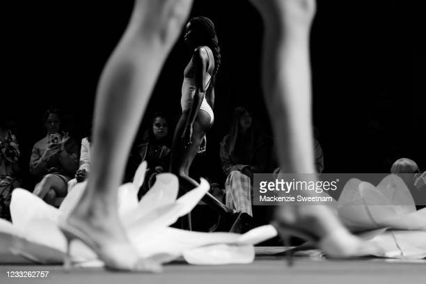 Model walks the runway during the Indigenous Fashion Projects show during Afterpay Australian Fashion Week 2021 Resort '22 Collections at...