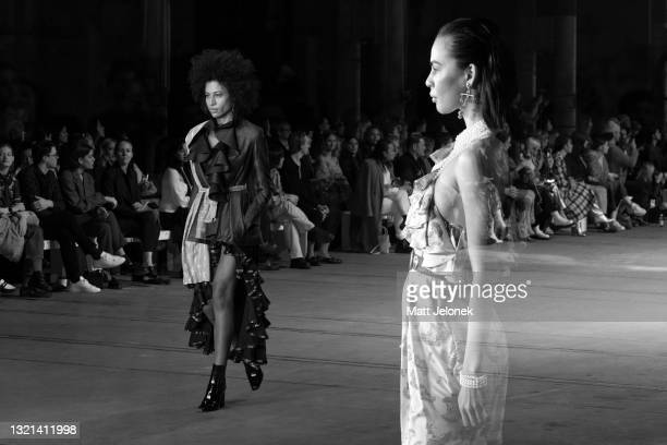 Model walks the runway during The Innovators: FDS TAFE NSW show wearing a design by Alexandra Dowsing during Afterpay Australian Fashion Week 2021...