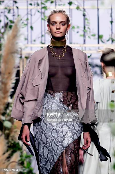 A model walks the runway during the Inunez show at Mercedes Benz Fashion Week Madrid Spring/Summer 2019 on July 10 2018 in Madrid Spain