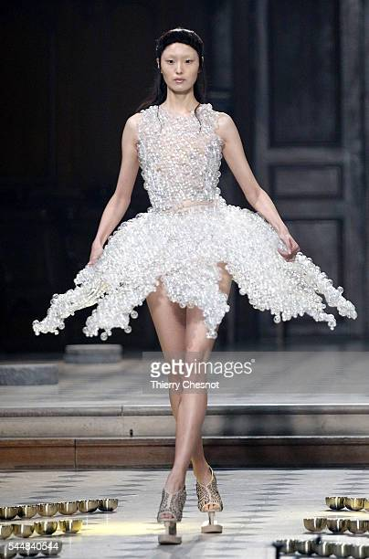 A model walks the runway during the Iris Van Herpen Haute Couture Fall/Winter 20162017 show as part of Paris Fashion Week on July 4 2016 in Paris...