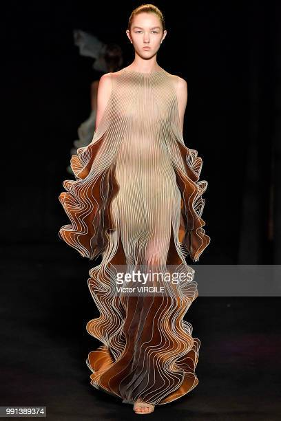 A model walks the runway during the Iris Van Herpen Haute Couture Fall Winter 2018/2019 fashion show as part of Paris Fashion Week on July 2 2018 in...