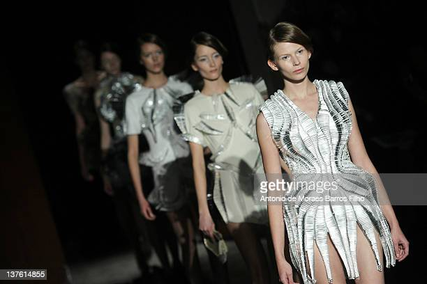 A model walks the runway during the Iris Van Herpen HauteCouture 2012 show as part of Paris Fashion Week on January 23 2012 in Paris France