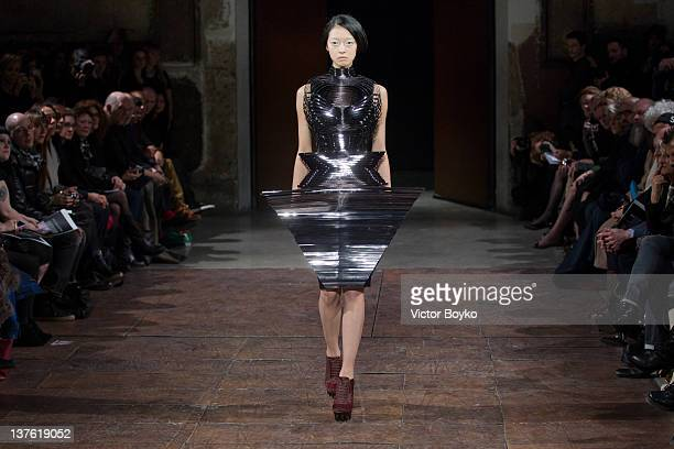A model walks the runway during the Iris Van Herpen HauteCouture 2012 show as part of Paris Fashion Week as part of Paris Fashion Week on January 23...