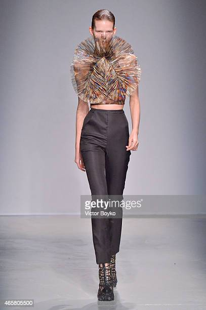 Model walks the runway during the Iris Van Herpen show as part of the Paris Fashion Week Womenswear Fall/Winter 2015/2016 on March 10, 2015 in Paris,...