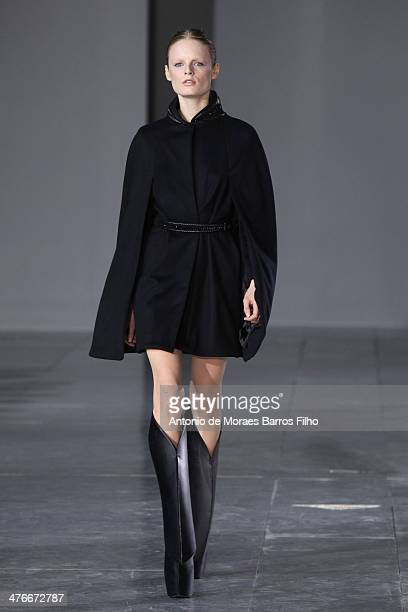A model walks the runway during the Iris Van Herpen show as part of the Paris Fashion Week Womenswear Fall/Winter 20142015 on March 4 2014 in Paris...