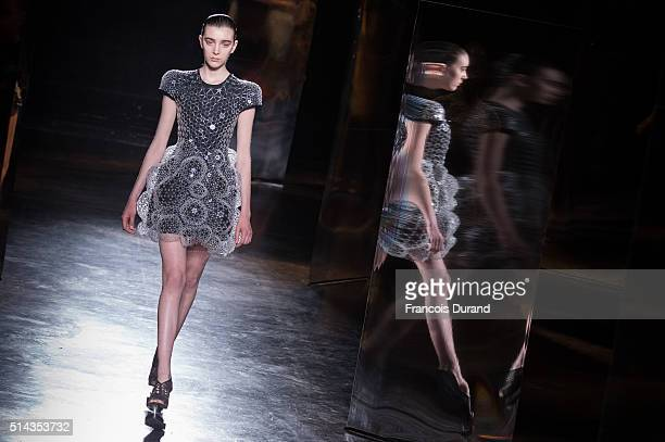 A model walks the runway during the Iris Van Herpen show as part of the Paris Fashion Week Womenswear Fall/Winter 2016/2017 on March 8 2016 in Paris...