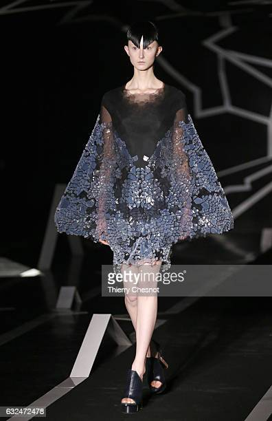 A model walks the runway during the Iris Van Herpen Spring Summer 2017 show as part of Paris Fashion Week on January 23 2017 in Paris France
