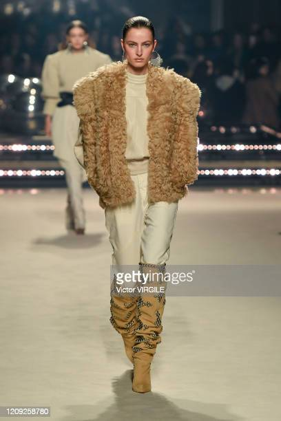 Model walks the runway during the Isabel Marant Ready to Wear fashion show as part of the Paris Fashion Week Womenswear Fall/Winter 2020/2021 on...