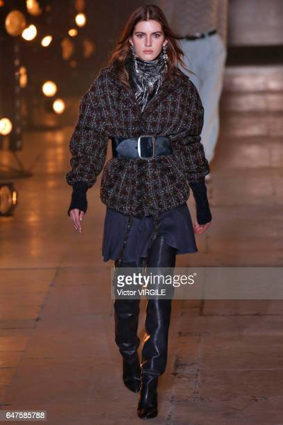 A model walks the runway during the Isabel Marant Ready to Wear fasshion show as part of the Paris Fashion Week Womenswear Fall/Winter 2017/2018 on...