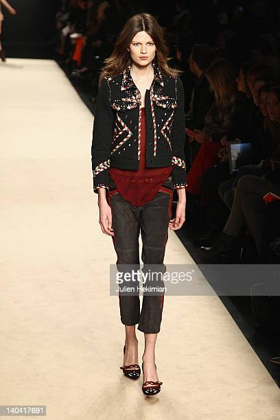 A model walks the runway during the Isabel Marant ReadyToWear Fall/Winter 2012 show as part of Paris Fashion Week at Couvent des Cordeliers on March...
