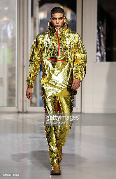 A model walks the runway during the Issey Miyake Men Autumn / Winter 2013 show as part of Paris Fashion Week on January 17 2013 in Paris France