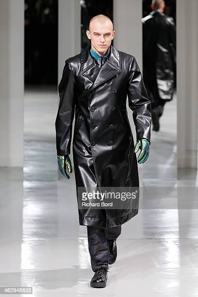 A model walks the runway during the Issey Miyake Men Menswear Fall/Winter 20142015 show as part of Paris Fashion Week on January 16 2014 in Paris...