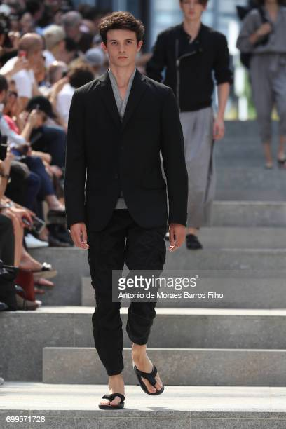 A model walks the runway during the Issey Miyake Men Menswear Spring/Summer 2018 show as part of Paris Fashion Week on June 22 2017 in Paris France