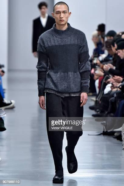 b108caf12f8f ... Paris Fashion Week - Menswear F W 2018-2019. A model walks the runway  during the Issey Miyake Men Menswear Fall Winter 20182019 show