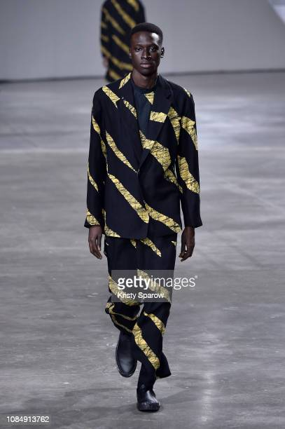 Model walks the runway during the Issey Miyake Men Menswear Fall/Winter 2019-2020 show as part of Paris Fashion Week on January 17, 2019 in Paris,...