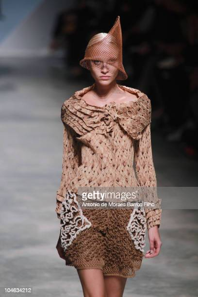 A model walks the runway during the Issey Miyake Ready to Wear Spring/Summer 2011 show during Paris Fashion Week at Palais De Tokyo on October 1 2010...