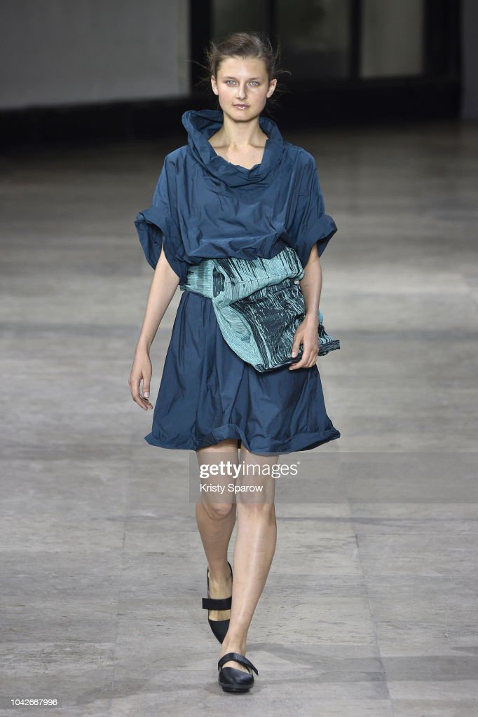 model-walks-the-runway-during-the-issey-miyake-show-as-part-of-paris-picture-id1042667996