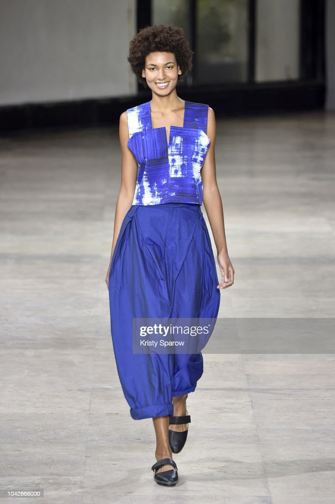 model-walks-the-runway-during-the-issey-miyake-show-as-part-of-paris-picture-id1042668000