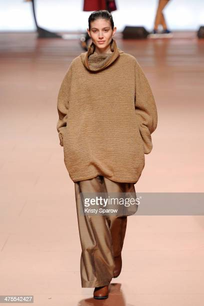 A model walks the runway during the Issey Miyake show as part of Paris Fashion Week Womenswear Fall/Winter 20142015 on February 28 2014 in Paris...